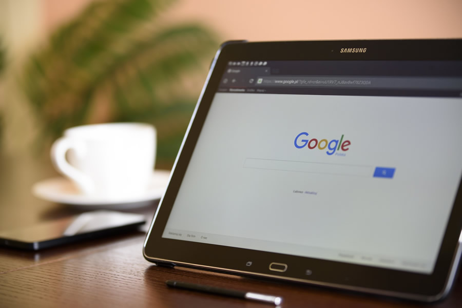 Ipad on Desk displaying Google search Page